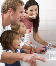 family brushing teeth home care