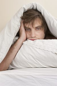 man tired restless fatigue