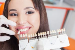 Happy woman with porcelain veneers