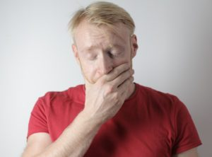 Man in pain from a dental emergency